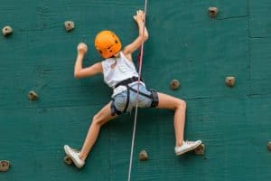 Girl indoor climbing